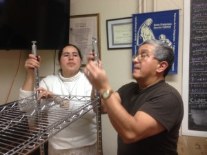 Claudia and Pedro Pizzarro assembling shelves